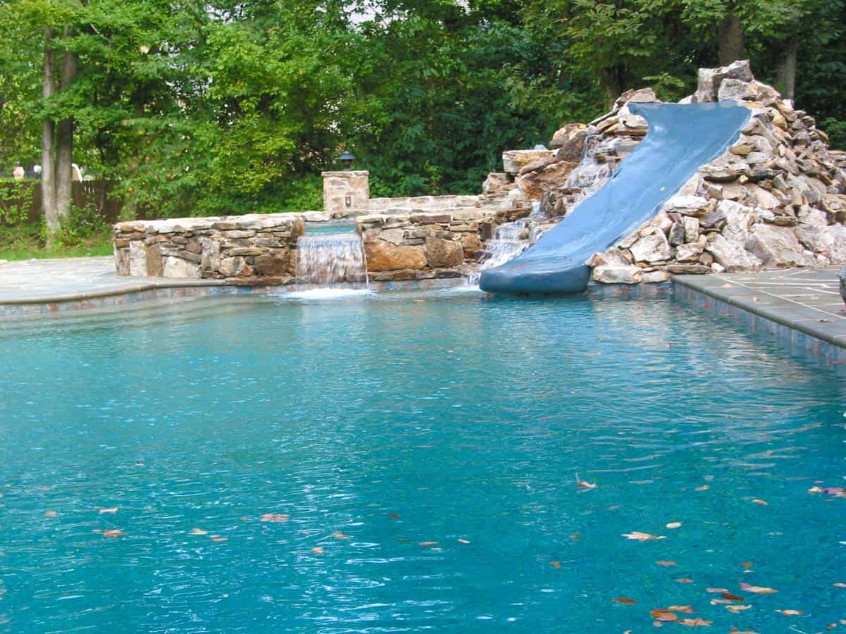 cool pool slide rock formation waterfall pool - Cool Pools With Waterfalls And Slides